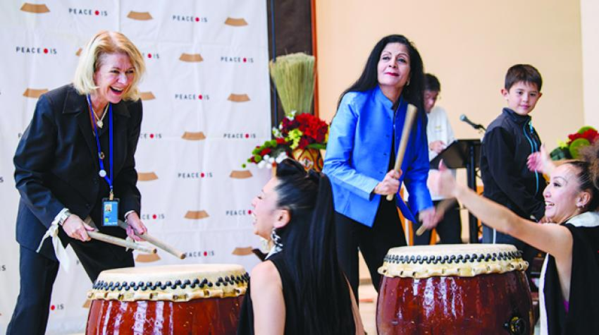 """Performance by the New York-based group Cobu, whose motto, """"Dance Like Drumming, Drum Like Dancing"""". Alison Smale (left) takes part in the event. 13 November 2017. © UN Photo/Manuel Elias"""