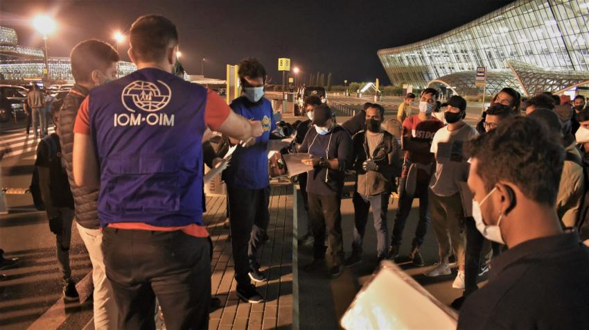 IOM Azerbaijan staff helping a group of stranded Sri Lankans return home. The majority were students or businesspeople who were unable to continue studying or trading due to COVID-19 restrictions. © IOM 2020