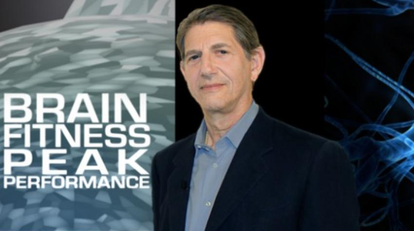 "TV poster with the title, ""Brain Fitness Peak Performance,"" on the left and the host of the show on the right."