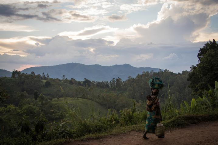 Brandau A woman, carrying her child, walks back to her home from the fields in DR Congo's North Kivu province. The situation in the region remains highly volatile, with civilians bearing the brunt of armed group violence.
