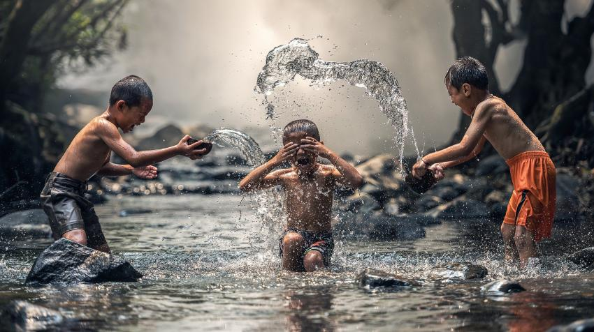 Boys playing in a stream, 6 March 2016. Photo by Sasin Tipchai from Pixabay,