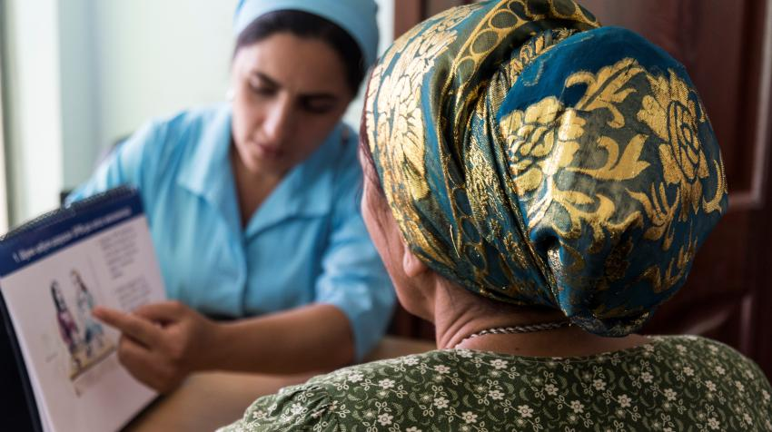 A nurse counsels a patient on viral load suppression at the City AIDS Center in Dushanbe, Tajikistan. Photo credit: Hugh Siegel/ICAP. March 2018