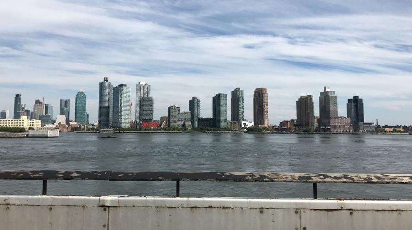 View of the east river and Long Island City from the patio of the green area.