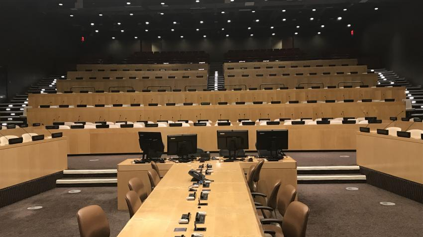 View of the ECOSOC chamber from the front of the room, with several floors of chairs for both speakers and the audience.