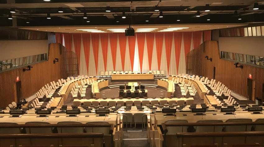 Overview of the ECOSOC chamber, with reclining seats for audience and actual chamber with seats arranged around the room.