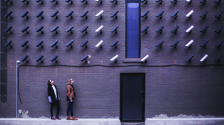 Two women look up at security cameras in Toronto, Canada. ©Unsplash/Matthew Henry