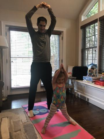 father and young daughter exercising