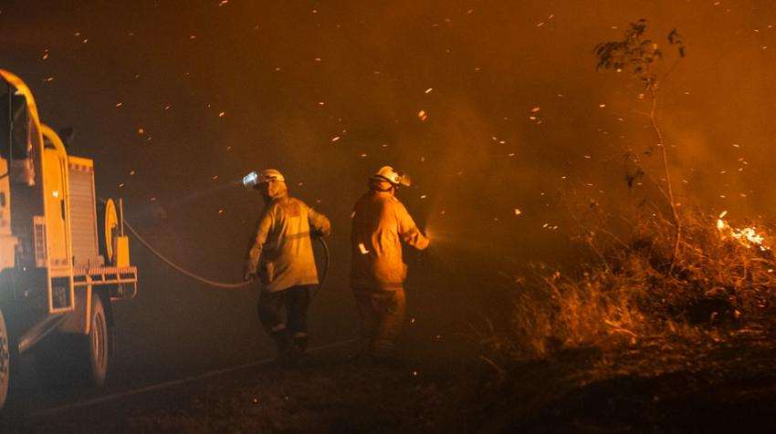 Firefighters in Queensland, Australia, tackle a blaze in January 2020