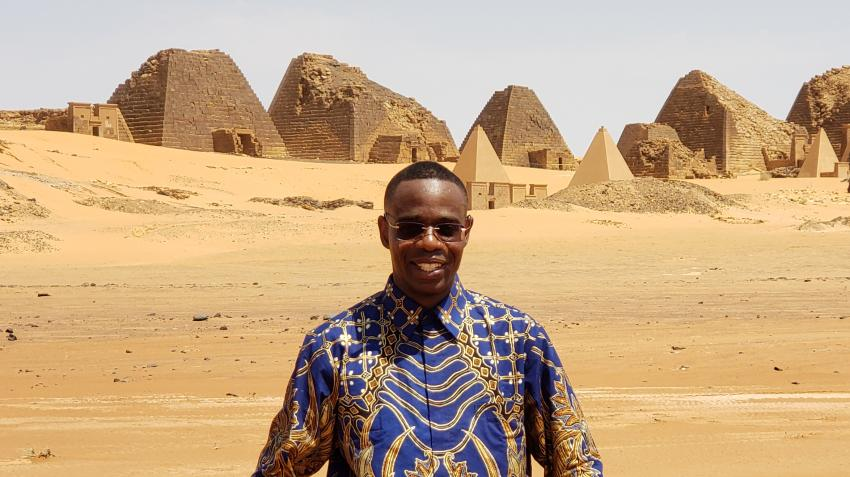 DGC staff member Lonjezo Hamisi standing in front of the ancient Nubian pyramids in Meroe, northern Sudan (16 August 2019/Lonjezo Hamisi).