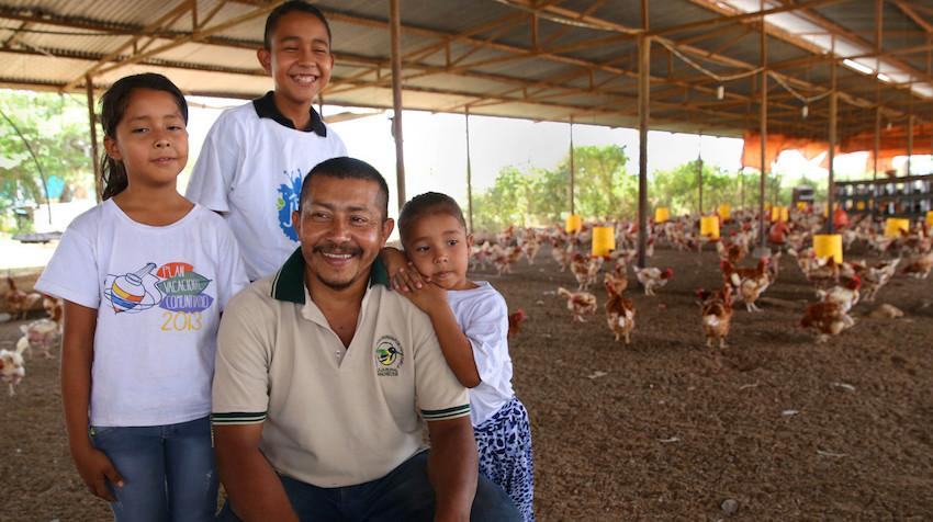 Image of family at their chicken farm