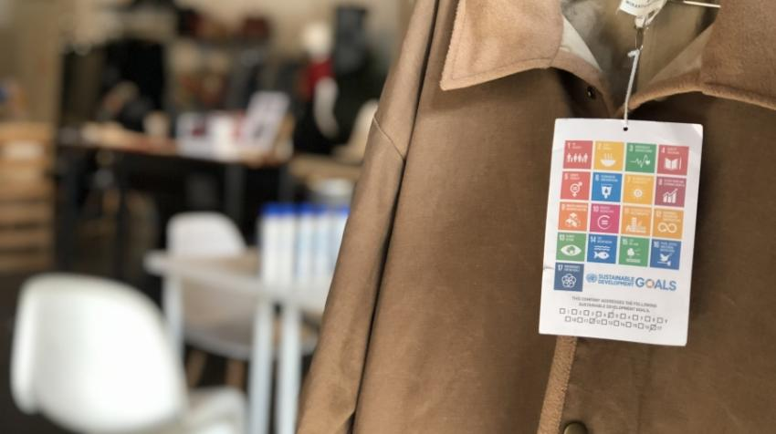 Sustainable Development Goals tags on display at a clothing donation event hosted by The Canvas during the ReFashion Week.