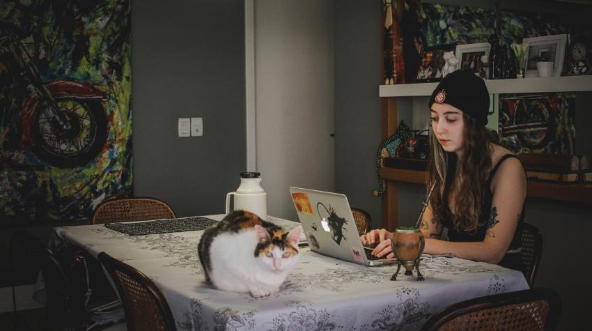 Joana Berwanger sits with a 'chimarrão', a typical south-Brazilian drink, and her cat in Porto Alegre, Brazil. United Nations photo: Joana Berwanger