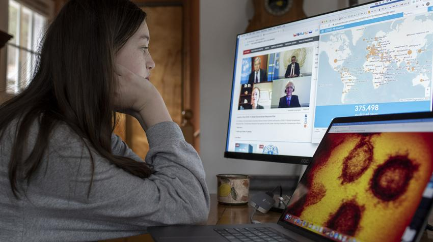 Young woman follows the virtual briefing on screen.