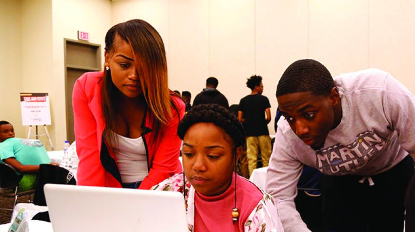 Competitors in the National Urban League's annual Hackathon work to develop digital solutions to social justice challenges. © national urban league