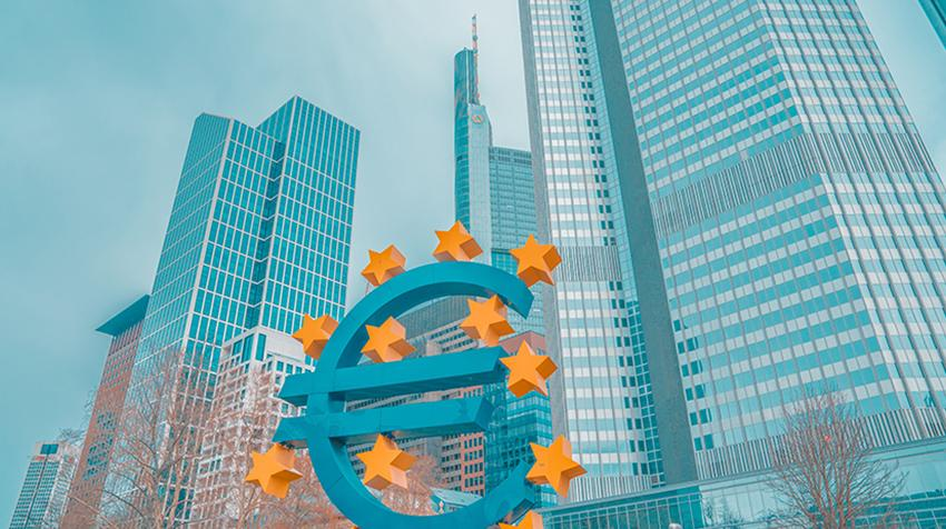 City landscape with sign representing the Euro currency