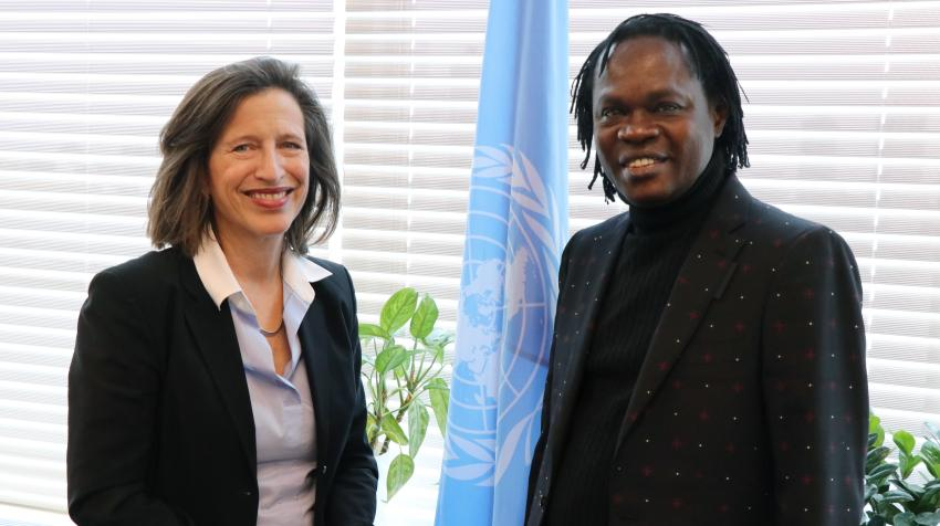 Noted Senegalese singer Baaba Maal (right), who performed at the Metropolitan Museum's Sahel exhibition, meets United Nations Under-Secretary-General for Global Communications, Melissa Fleming (left). New York, 11 March 2020. Photo: Steven Bornholtz.