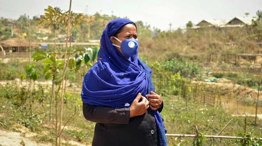 woman with face mask standing in garden