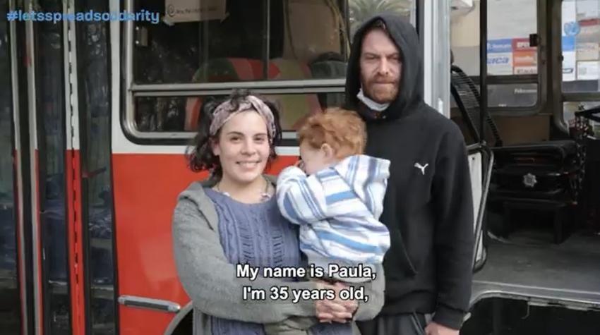Paula and Ariel, a couple helped by neighbors who live on a parked bus in Buenos Aires, Argentina.