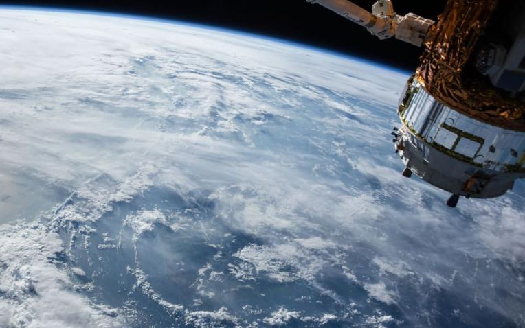 A satellite over the Earth.