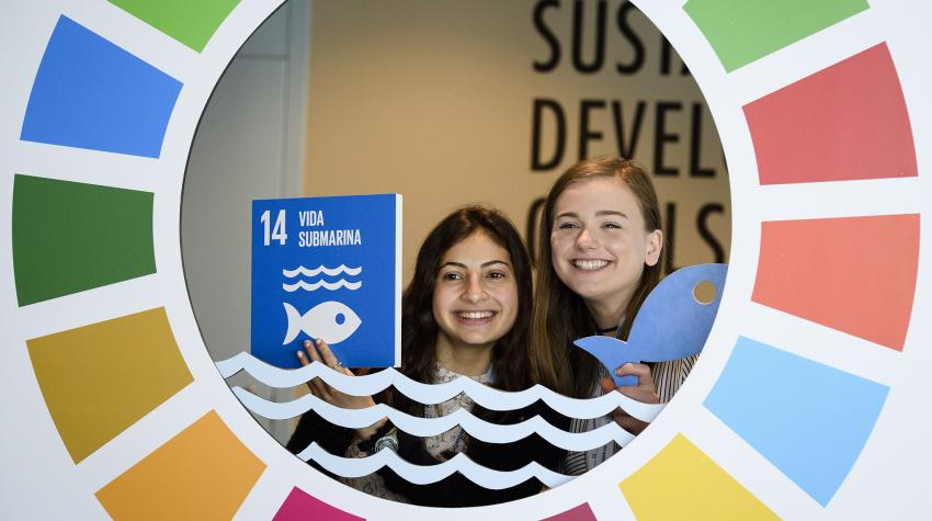 Visitors to the UN Ocean Conference pose for a picture inside of a display about the Sustainable Development Goals at UN headquarters in New York from 5 to 9 June 2017.