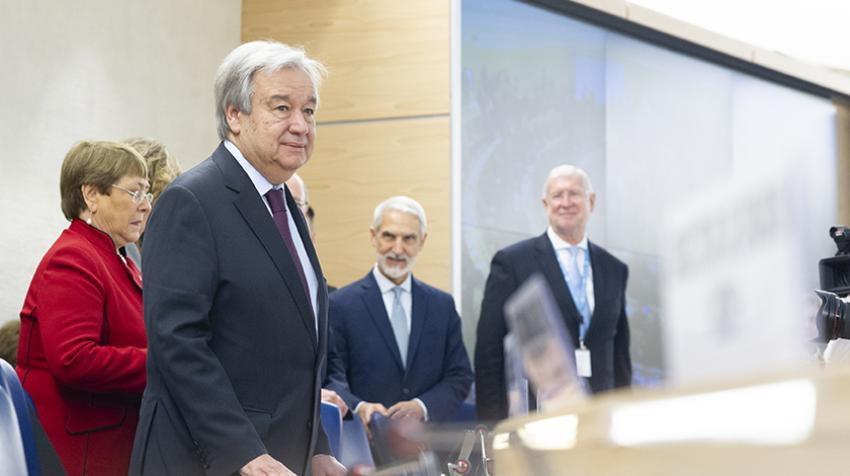 Secretary-General António Guterres standing at podium with other UN officials behind him.