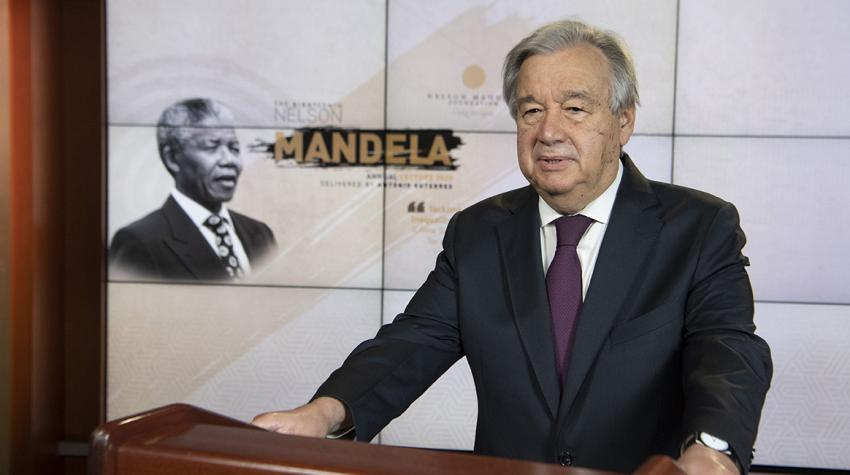 Secretary-General António Guterres at podium with Nelson Mandela portrait in the background