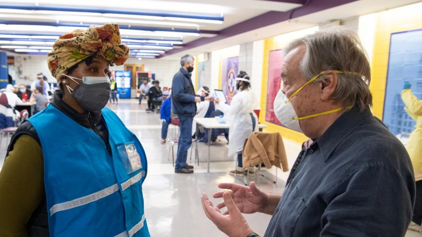Secretary-General António Guterres speaks with hospital worker