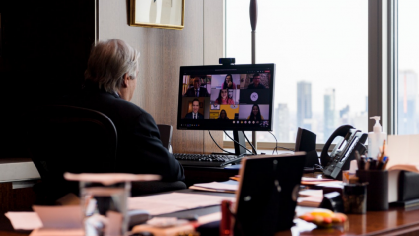 Secretary-General António Guterres attends a virtual meeting from his office with the Youth Advisory Group on Climate Change.