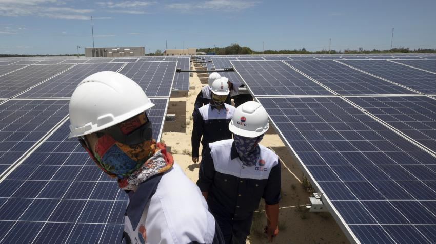 workers on solar panel roof