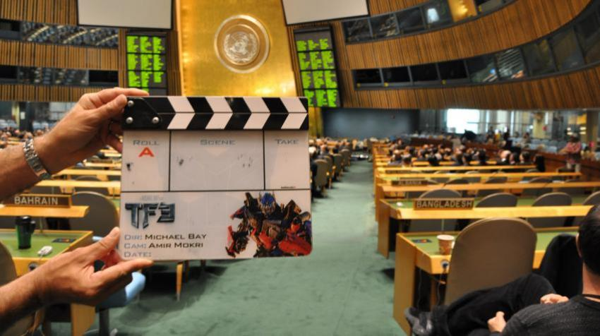Person holding clapperboard in General Assembly Hall