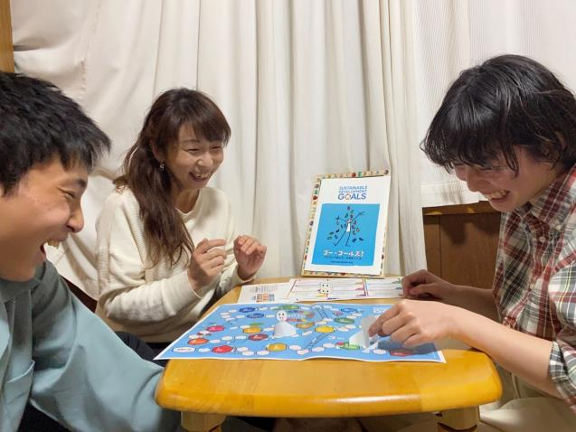 """A family in Tokyo enjoys the """"Go Goals!"""" board game"""