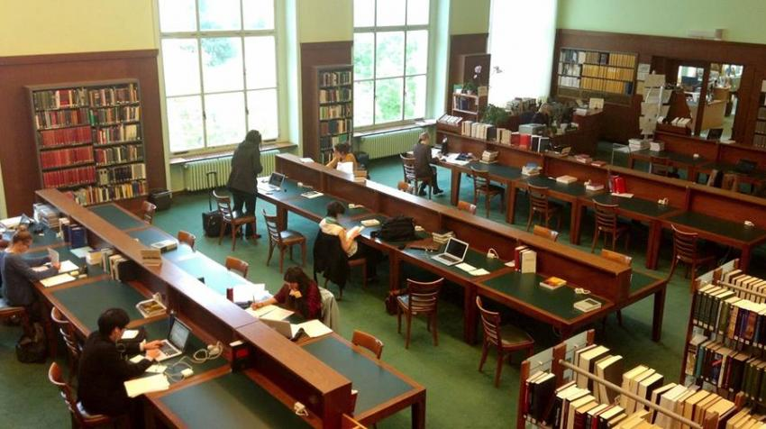 Bird's Eye view of the library with study desks and book shelves.