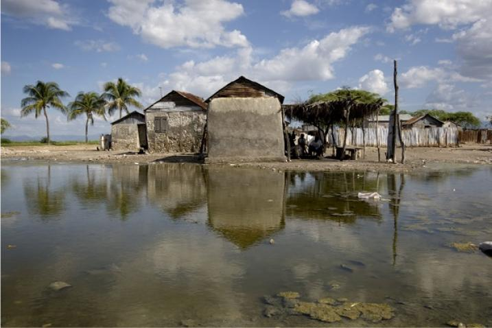 House surrounded by flooding from the Artibonite River in Grand Dessalines, Haiti.