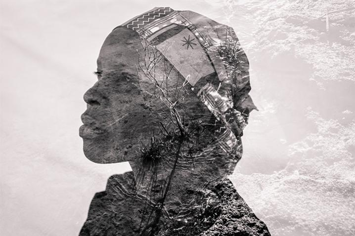 Superimposed image of a profile of a woman against the texture of the earth