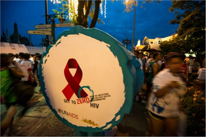 Person disguised as a drum with the slogan Getting to Zero HIV in Bangkok, Thailand.