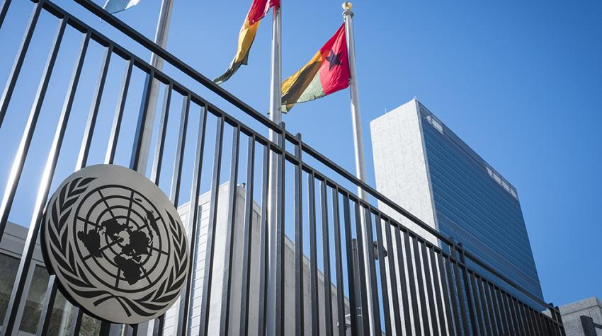 A view of the United Nations Secretariat Headquarters Building and the flags of UN member states on First Avenue in New York City.