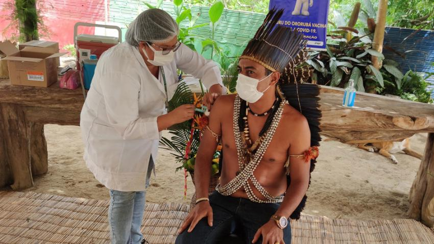 An indigenous man receives his COVID-19 vaccination in Brazil.