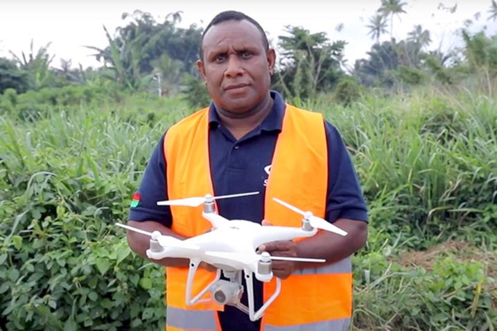 A man holding a drone.