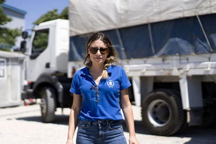 Woman wearing WFP t-shirt in front of a truck.