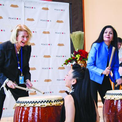 "Performance by the New York-based group Cobu, whose motto, ""Dance Like Drumming, Drum Like Dancing"".  Alison Smale (left) takes part in the event. 13 November 2017. © UN Photo/Manuel Elias"