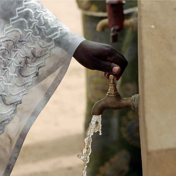 Clean drinking water runs freely from a communal water faucet.
