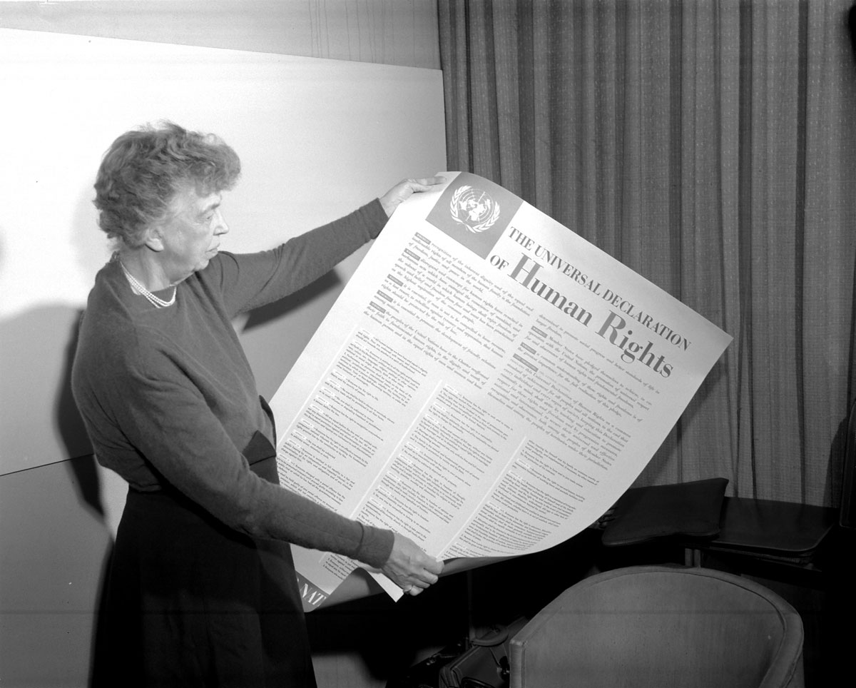 Mrs. Eleanor Roosevelt of the United States holding a Declaration of Human Rights poster in English