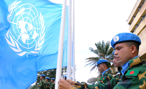 Peacekeepers raise the UN flag