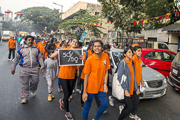 Youth dressed in orange march against gender violence