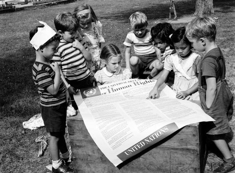 Photo courtesy of the United Nations: Students at the UN International Nursery School in New York look at a poster of the Universal Declaration of Human Rights in 1950.