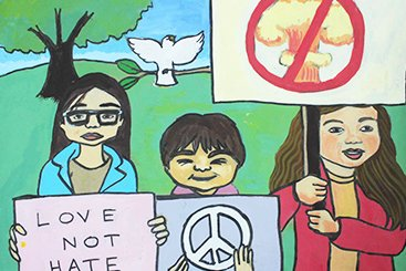 "Painting of 3 children holding up posters with ""love not hate"", the peace symbol, and a nuclear mushroom cloud with a line crossing it out. There is a white dove and tree behind them."