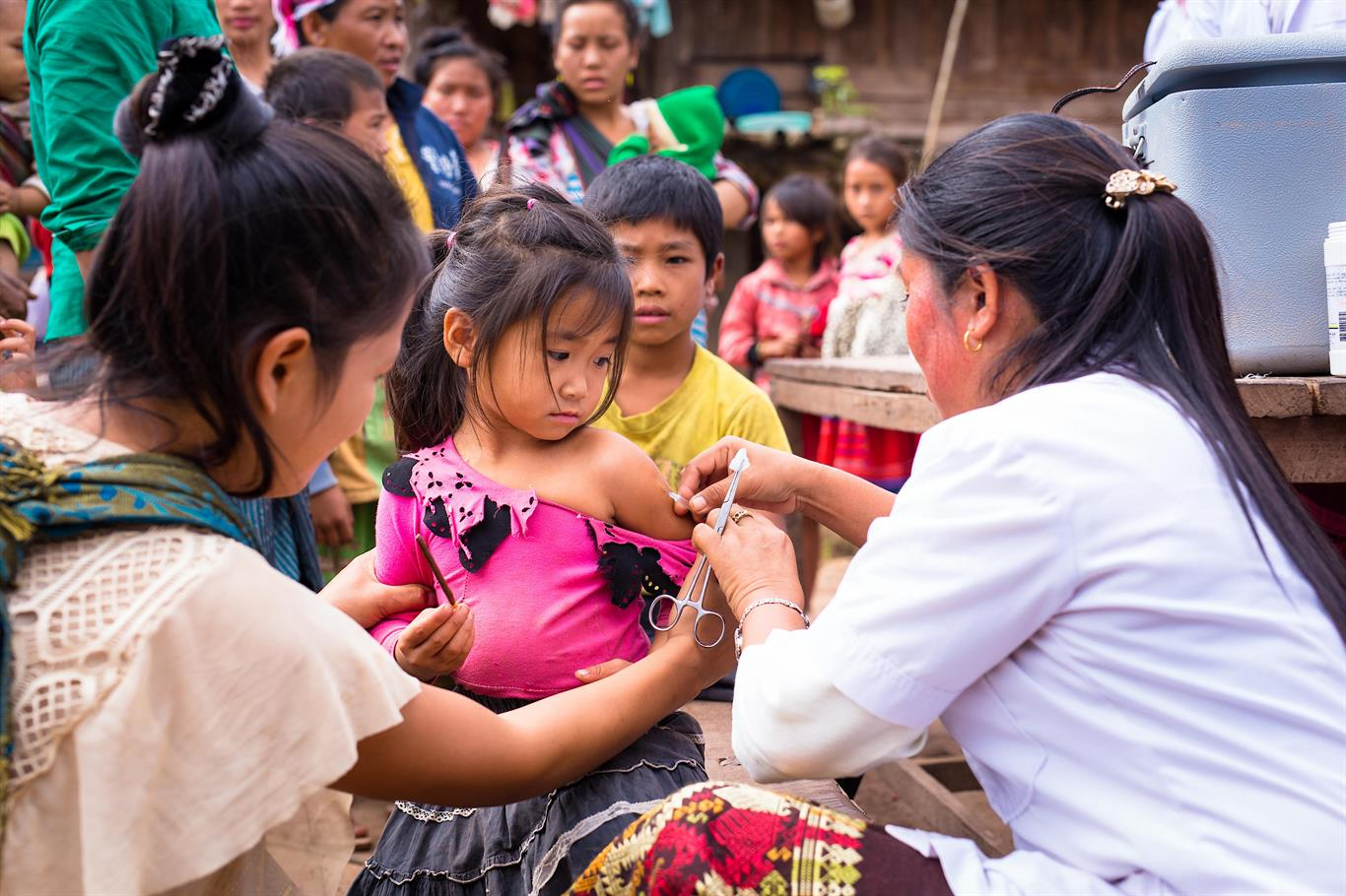 A girl gets vaccinated against measles.
