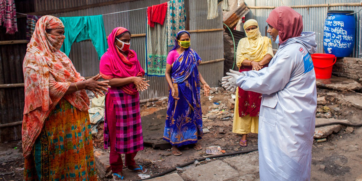 Women in Bangladesh being taught how to sanitize their hands