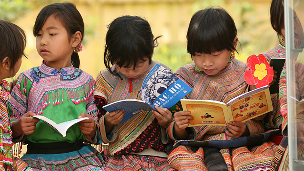 young girls reading books