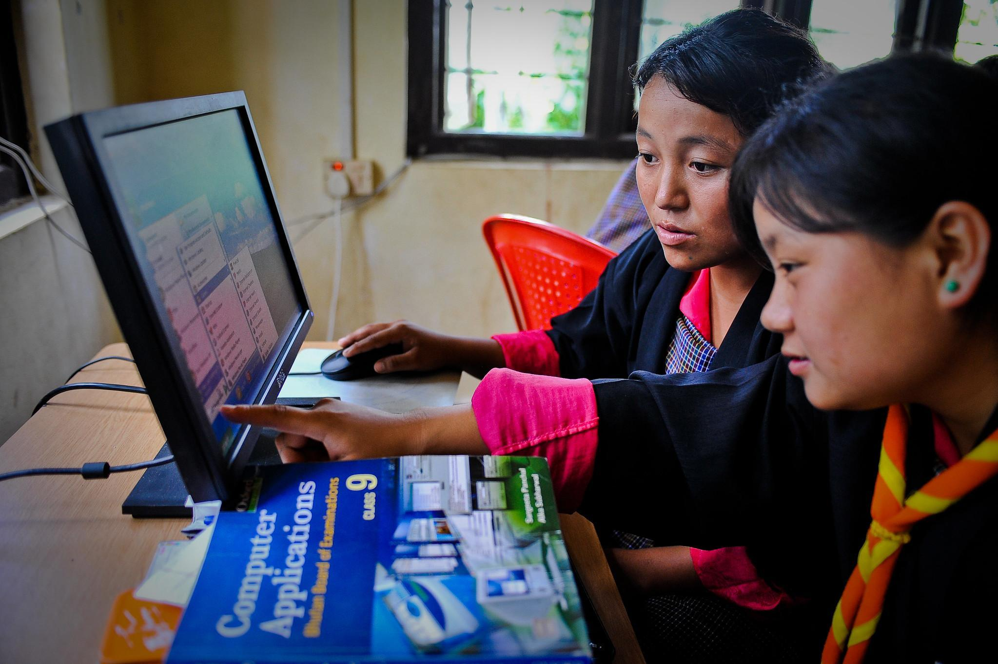 Students practice computer exercises at the community e-Center in Bhutan.